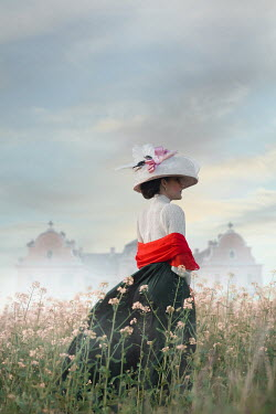 Ildiko Neer Historical woman standing in meadow by mansion
