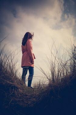 Marie Carr BRUNETTE WOMAN STANDING IN LONG GRASS