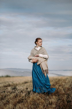 Magdalena Russocka historical woman holding baby in field