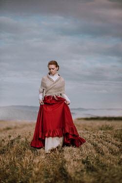 Magdalena Russocka historical woman walking in field