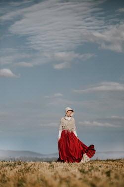 Magdalena Russocka historical woman wearing bonnet standing in field