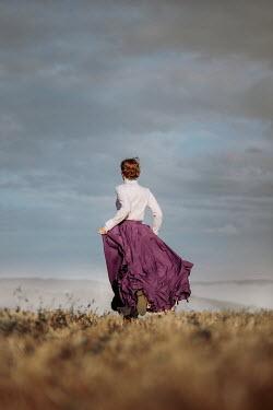 Magdalena Russocka historical woman running in field