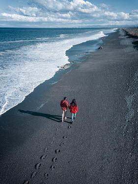 Mary Wethey COUPLE HOLDING HANDS WALKING ON BEACH