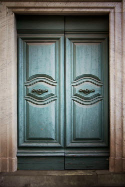 Victoria Davies MARBLE BUILDING WITH CLOSED WOODEN DOORS