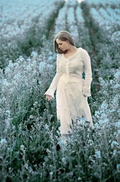 Carmen Spitznagel GIRL IN WHITE STANDING IN FIELD WITH FLOWERS