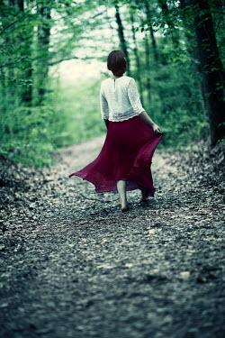 Carmen Spitznagel BAREFOOT WOMAN WALKING ON FOREST PATH