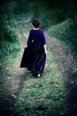 Carmen Spitznagel BAREFOOT WOMAN WALKING ON COUNTRY ROAD