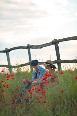 Ildiko Neer Vintage couple sitting by fence