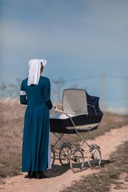 Ildiko Neer Wartime nurse with pram on country road