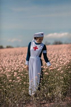 Ildiko Neer Wartime nurse standing in meadow