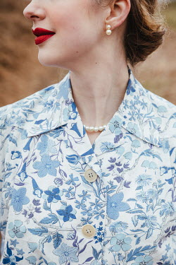 Matilda Delves RETRO WOMAN IN FLORAL BLOUSE OUTDOORS
