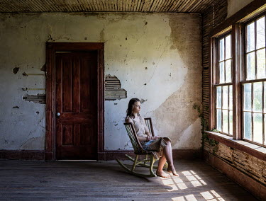 Rodney Harvey WOMAN SITTING IN ABANDONED HOUSE