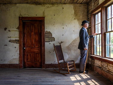 Rodney Harvey MAN WITH HAT AND CANE BY WINDOW IN SHABBY HOUSE