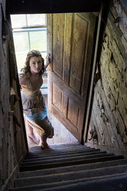 Rodney Harvey WOMAN IN DOORWAY AND STEPS OF DERELICT HOUSE