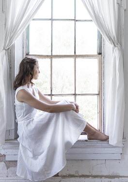 Rodney Harvey BAREFOOT WOMAN IN WHITE SITTING BY WINDOW