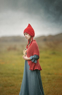 Anna Buczek GIRL WITH POINTED HAT STANDING IN FIELD