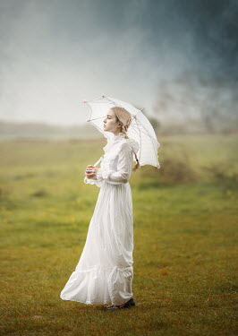 Anna Buczek BLONDE GIRL IN WHITE WITH PARASOL IN COUNTRYSIDE