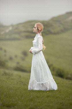 Anna Buczek BLONDE GIRL IN WHITE ON HILL IN COUNTRYSIDE