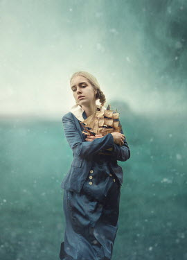 Anna Buczek BLONDE GIRL HOLDING MODEL SHIP OUTDOORS