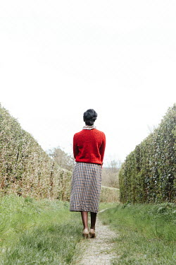 Matilda Delves BLACK WOMAN IN TWEED SKIRT ON COUNTRY LANE