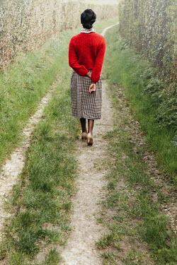 Matilda Delves BLACK WOMAN IN TWEED SKIRT IN COUNTRY LANE