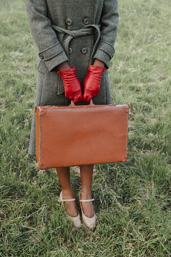 Matilda Delves RETRO WOMAN WITH RED GLOVES CARRYING SUITCASE