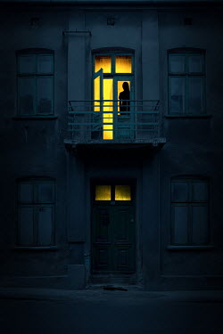 Magdalena Russocka silhouette of woman standing in balcony door of old building at night