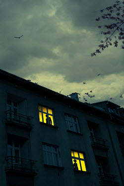 Magdalena Russocka silhouettes of man and woman in windows of old building at night