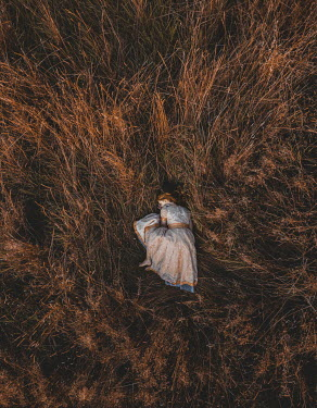 Mary Wethey HISTORICAL WOMAN SLEEPING IN FIELD