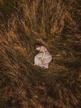 Mary Wethey HISTORICAL GIRL SLEEPING IN FIELD