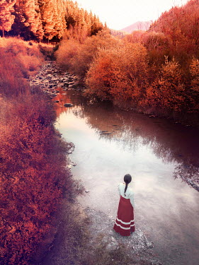 Mary Wethey BRUNETTE WOMEN STANDING BY RIVER IN AUTUMN