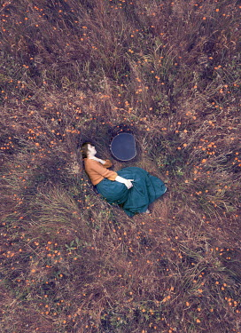Mary Wethey HISTORICAL WOMAN WITH CASE SLEEPING IN FIELD