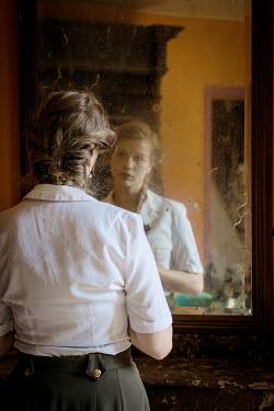 Elly De Vries SAD RETRO WOMAN REFLECTED IN MIRROR