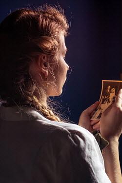 Elly De Vries RETRO WOMAN LOOKING AT PHOTOGRAPH