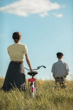 Ildiko Neer Vintage couple standing separately in meadow