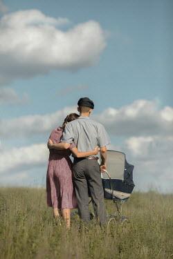 Ildiko Neer Vintage couple with pram in field