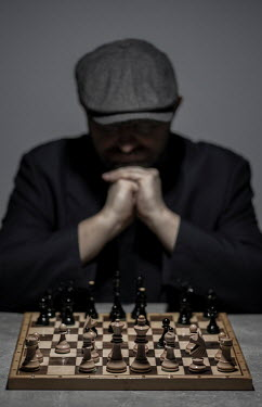 Jaroslaw Blaminsky MAN IN CAP PLAYING CHESS
