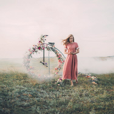 Jovana Rikalo GIRL IN FIELD WITH FLORAL PENNY FARTHING