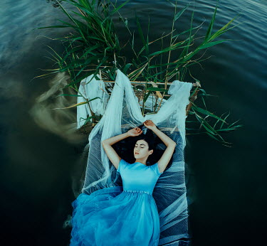 Katerina Klio WOMAN LYING ON BED IN LAKE