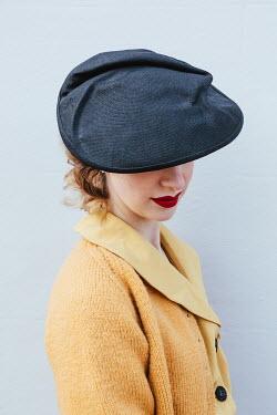 Matilda Delves RETRO WOMAN IN HAT APPLYING LIPSTICK