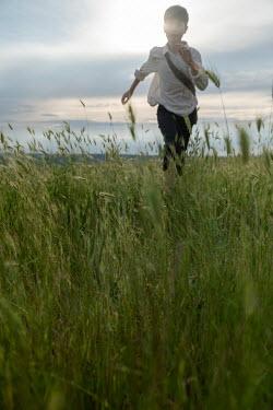 Galya Ivanova BOY RUNNING IN FIELD WITH LONG GRASS