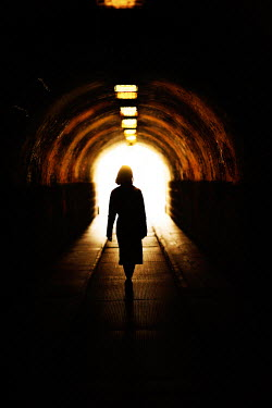 Nikaa SILHOUETTED WOMAN IN DARK TUNNEL