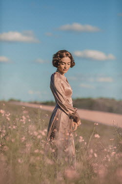 Ildiko Neer Vintage woman standing in meadow