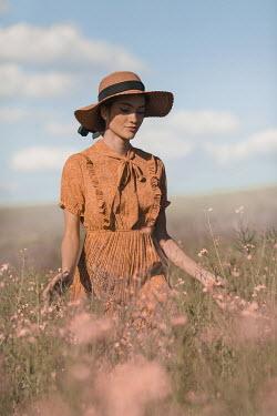 Ildiko Neer Vintage woman walking in meadow