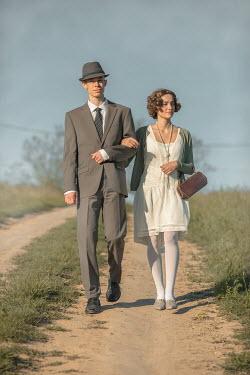 Ildiko Neer Vintage couple walking on country road