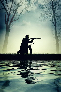 Magdalena Russocka modern man aiming with rifle with scope by river