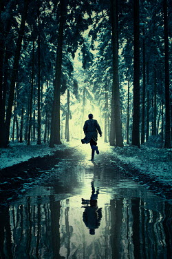 Magdalena Russocka modern man running by puddle in snowy forest