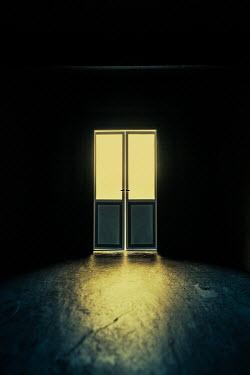 Magdalena Russocka double door with light in dark room