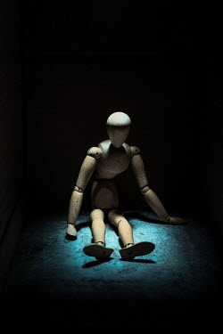 Magdalena Russocka wooden mannequin figure sitting in shadow
