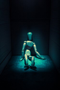 Magdalena Russocka posable wooden mannequin figure sitting in shadow